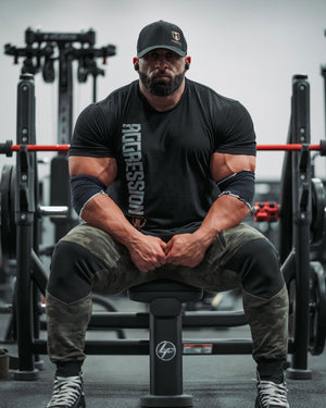 Bodybuilder Fouad Abiad Sitting on Bench in Gym