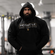Bodybuilder Fouad Abiad wearing Hosstile Signature hoodie in black
