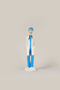 Hand-made clay figurine, Dr.Angel is wearing traditional blue scrubs and a white coat, all our Catrines and Catrinas are made in Mexico, we ship worldwide. Add a classy touch of Mexican art to your home or office. The Earth's Angels collection was created to honor all front-line workers during the covid-19 pandemic.