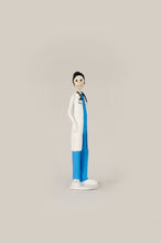 Load image into Gallery viewer, Hand-made clay figurine, Dr.Hope is wearing traditional blue scrubs and a white coat, all our Catrines and Catrinas are made in Mexico, we ship worldwide. Add a classy touch of Mexican art to your home or office. The Earth's Angels collection was created to honor all front-line workers during the covid-19 pandemic.