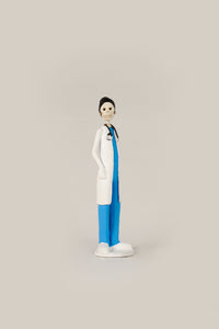 Hand-made clay figurine, Dr.Hope is wearing traditional blue scrubs and a white coat, all our Catrines and Catrinas are made in Mexico, we ship worldwide. Add a classy touch of Mexican art to your home or office. The Earth's Angels collection was created to honor all front-line workers during the covid-19 pandemic.