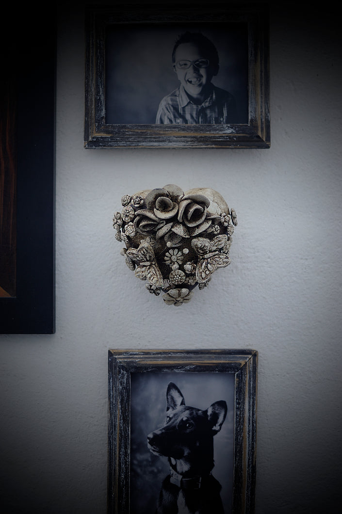 Hand-made clay heart, this beautiful heart is great for hanging on walls. It's decorated with flowers and butterflies all around it. This heart is one of a kind. All our Catrinas and hearts are made in Mexico and we ship worldwide. Add a classy touch of Mexican art to your home.