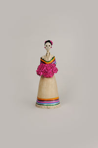 Hand-made clay figurine, the bottom of her dress and the wrap on her shoulders are painted to represent Mexican colors. She is holding a bouquet of pink roses that match the roses she is wearing for a headpiece. Bring a touch if Mexican culture to your home. We ship worldwide.