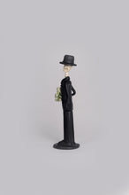 Load image into Gallery viewer, Hand-made clay figurine, Catrin Martin in gold is a small but fancy guy, he is wearing a tux with a gold tie and he is holding a gold rose bouquet. He is the perfect partner for any small Catrina. All our Catrines and Catrinas are made in Mexico and we ship worldwide. Add a classy touch of Mexican art to your home.
