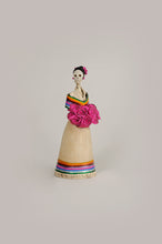 Load image into Gallery viewer, Hand-made clay figurine, the bottom of her dress and the wrap on her shoulders are painted to represent Mexican colors. She is holding a bouquet of pink roses that match the roses she is wearing for a headpiece. Bring a touch if Mexican culture to your home. We ship worldwide.