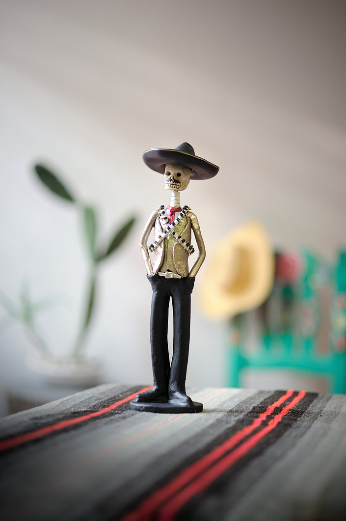 Hand-made clay figurine, Emiliano is one of our famous Catrines, he is wearing a charro hat and our famous bullet belt, all our Catrines and Catrinas are made in Mexico. We ship worldwide, add a classy touch of Mexican culture to your home or office.