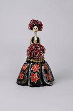 Load image into Gallery viewer, Hand-made clay figurine, made in Mexico. Shipped worldwide. Stunning Christmas catrina in black, poinsettias painted on her dress, small gold accents flowers under the bouquet, gorgeous red rose bouquet that compliments her headpiece.