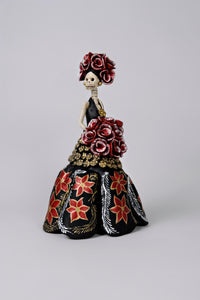 Hand-made clay figurine, made in Mexico. Shipped worldwide. Stunning Christmas catrina in black, poinsettias painted on her dress, small gold accents flowers under the bouquet, gorgeous red rose bouquet that compliments her headpiece.