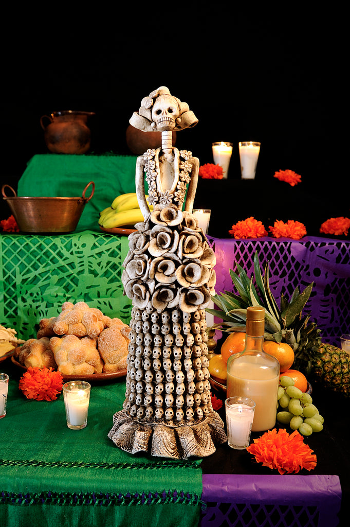 Hand-made clay figurine, Catrina Laura is part of our Day of the Dead collection. Her dress is made up of more than 200 small skulls carefully placed all around her skirt. She will look stunning as part of your Day of the Dead altar. All our Catrinas are made in Mexico and we ship worldwide. Add a classy touch of Mexican culture to your home.