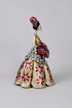 Load image into Gallery viewer, Hand-made clay figurine, made in Mexico. Shipped worldwide. Amanda in Gold is a stunning Christmas catrina, dress painted in gold, hand-painted poinsettias, small silver accent flowers under the bouquet, gorgeous red rose bouquet that compliments her headpiece.