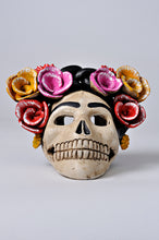Load image into Gallery viewer, Hand-made clay skull, decorated with flowers, it has an opening in the back so you can place a candle inside, decorate your Day of the Dead altar with one of these skulls. All our Catrinas and skulls are made in Mexico and shipped worldwide.