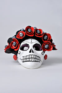 Hand-made clay skull, decorated with flowers and small skulls inside each flower, it has an opening in the back so you can place a candle inside, decorate your Day of the Dead altar with one of these skulls. All our Catrinas and skulls are made in Mexico and shipped worldwide.
