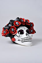 Load image into Gallery viewer, Hand-made clay skull, decorated with flowers and small skulls inside each flower, it has an opening in the back so you can place a candle inside, decorate your Day of the Dead altar with one of these skulls. All our Catrinas and skulls are made in Mexico and shipped worldwide.