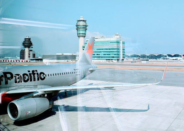 Traveling through the airport, photo by Distil