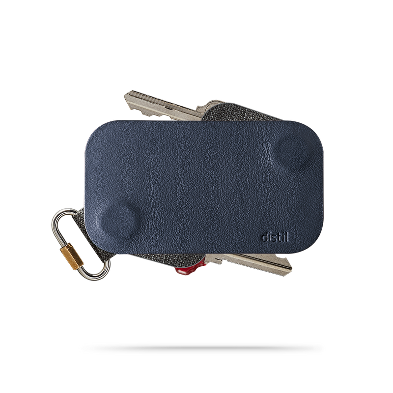 distil navy leather keyfolio with a fobring and two keymods on a white backdrop
