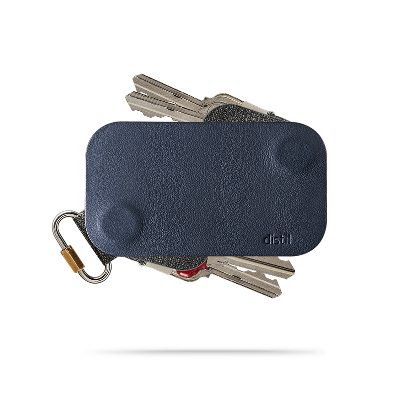 distil navy leather keyfolio with a fobring and four keymods on a white backdrop