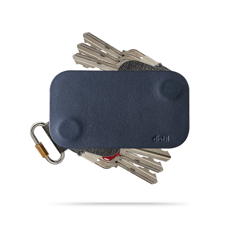 distil navy leather keyfolio with a fobring and six keymods on a white backdrop