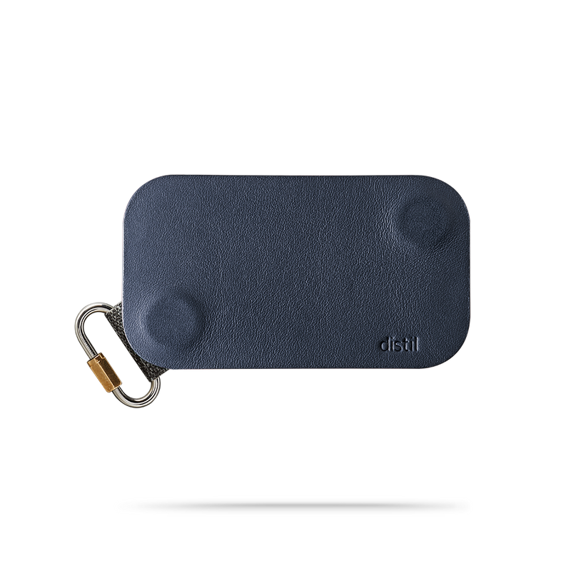 distil navy leather keyfolio with fobring on a white backdrop
