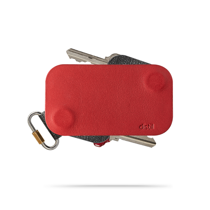 distil red leather keyfolio with a keymod protruding on top and bottom of the key organizer
