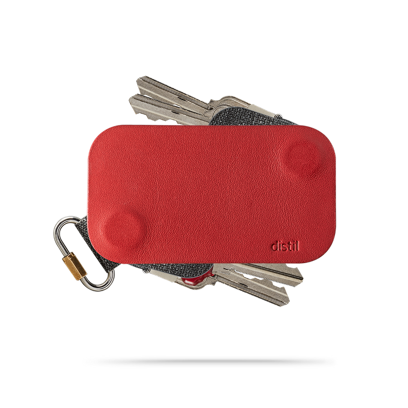 distil red leather keyfolio with two keymods protruding on top and bottom of the key organizer