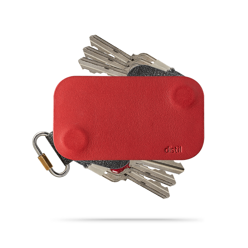 distil red leather keyfolio with three keymods protruding on top and bottom of the key organizer