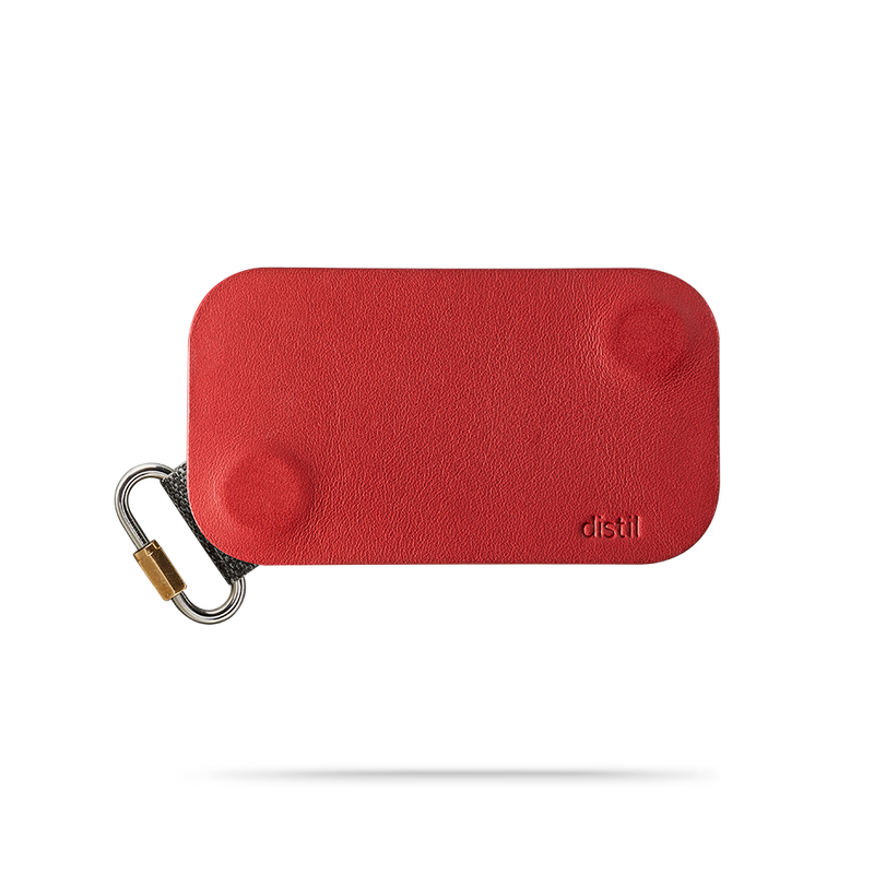 distil red leather keyfolio with fobring on the bottom left and distil logo on bottom right