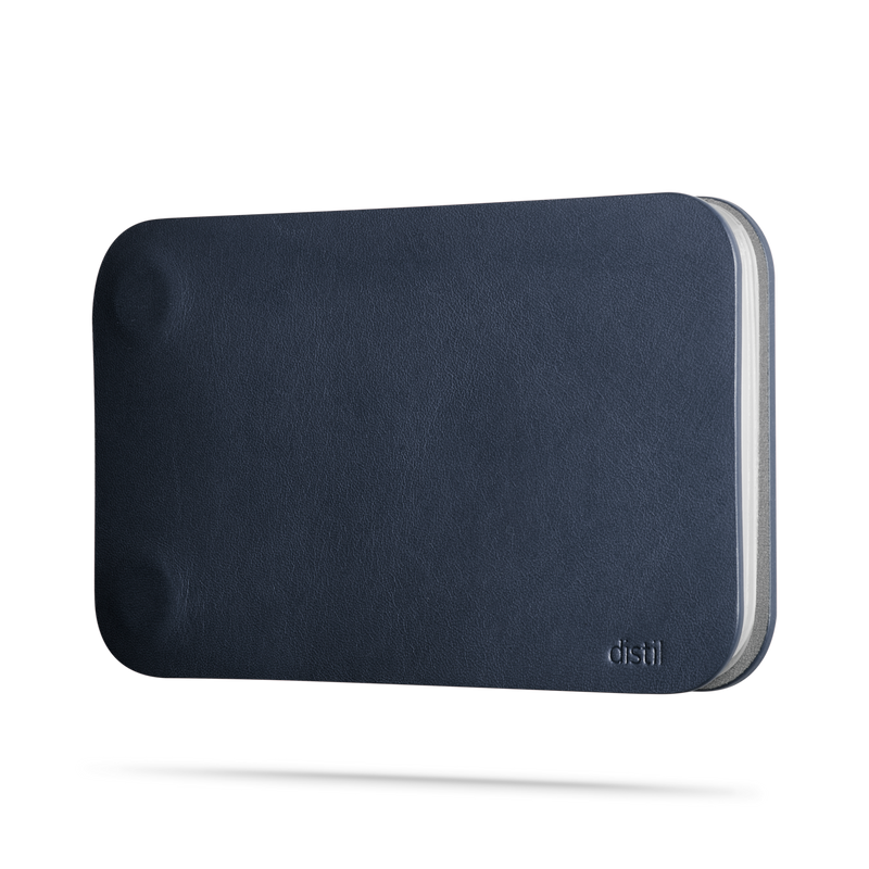 side view of navy leather modwallet cover with small distil logo on bottom right corner