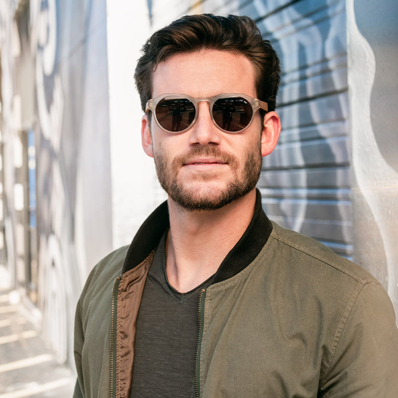 front view of man wearing distil cooper sunglasses with matte crystal frames and polarized lens