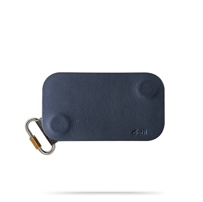 distil navy leather keyfolio with attached fobring on a white backdrop