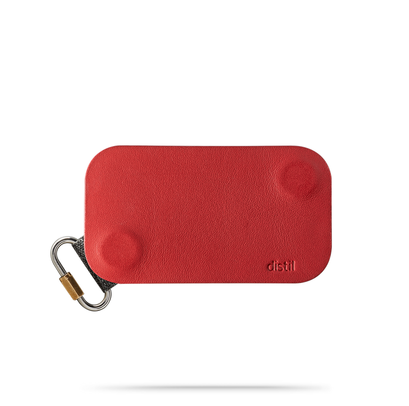 distil red leather keyfolio with attached fobring on a white backdrop