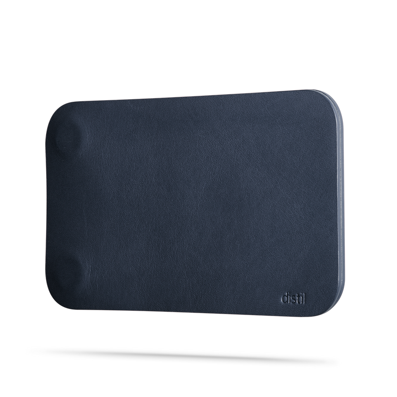 angle view of navy leather modwallet cover with small distil logo on bottom right corner