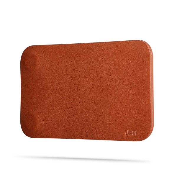 angle view of brown leather modwallet cover with small distil logo on bottom right corner