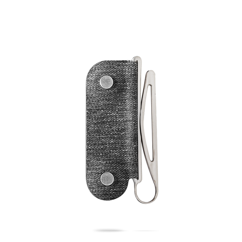 distil moneyclip made of cnc coated steel on a white backdrop
