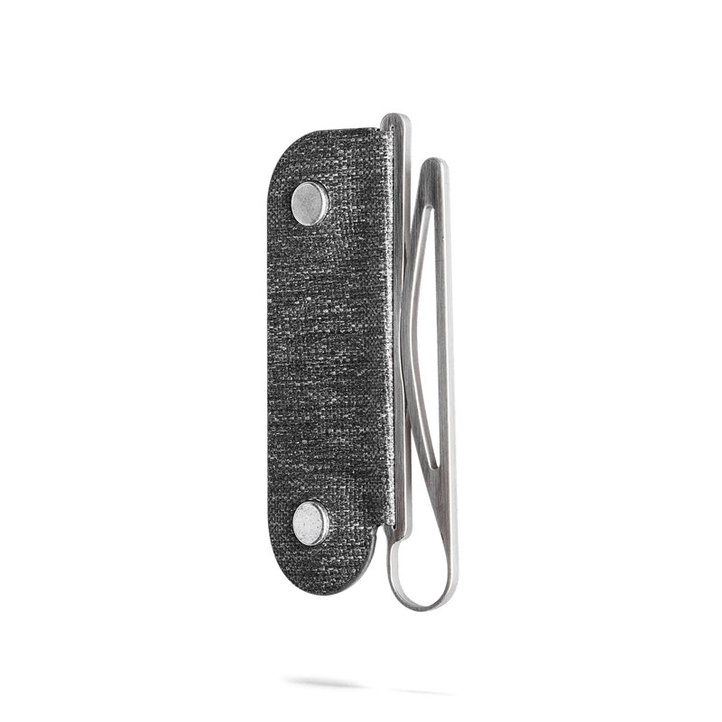 angle view of distil moneyclip made of cnc coated steel on a white backdrop
