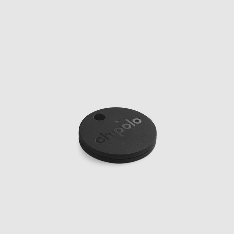 chipolo bluetooth tracker made in black for distil on a white backdrop