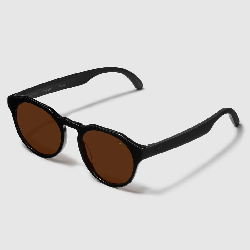 angle view of distil cooper sunglasses with black frames and amber polarized lens