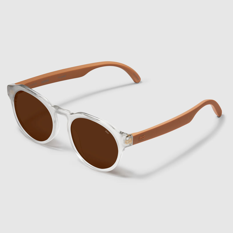 angle view of distil cooper sunglasses with matte crystal frames and amber polarized lens