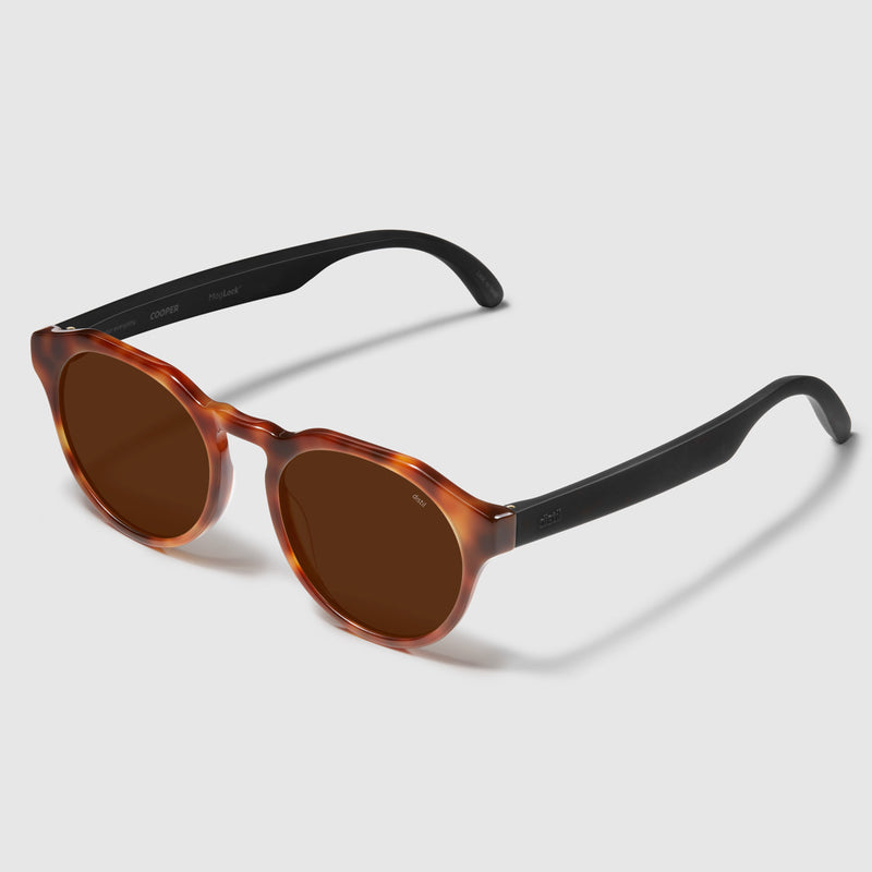 angle view of distil cooper sunglasses with tortoise frames and amber polarized lens