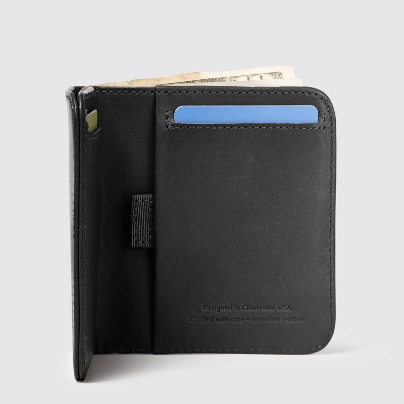 opened distil wally agent billfold wallet with a blue card and money protruding from the top