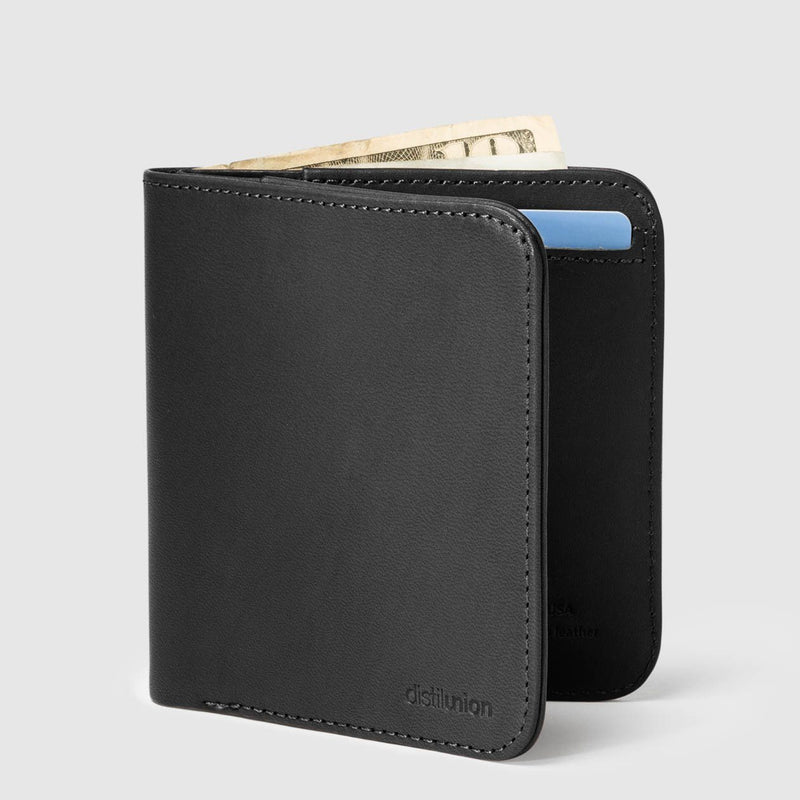 distil wally agent slim billfold wallet with money protruding from the top of the wallet