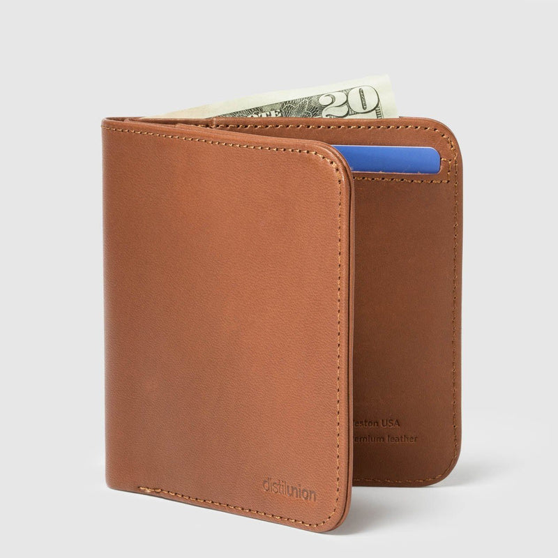 distil wally agent slim billfold wallet in hickory colour on a white backdrop