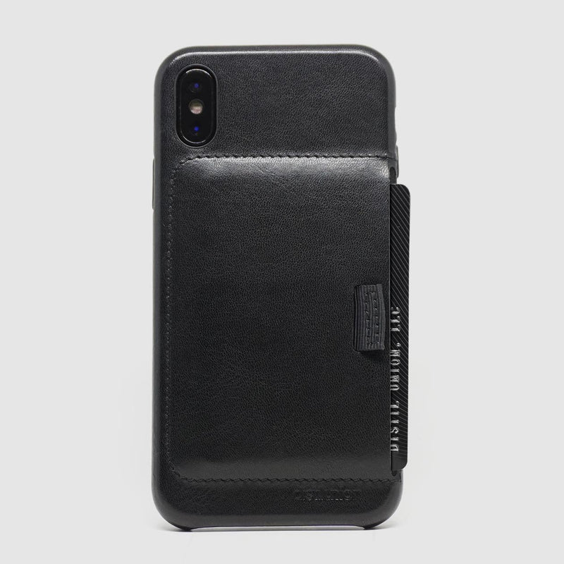 back view of distil black leather wally case for iphone x with protruding black credit card