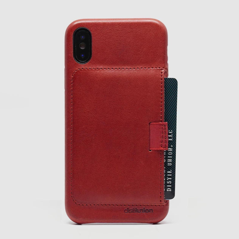 back view of distil red leather wally case for iphone x with protruding black credit card
