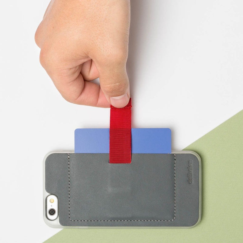 right hand using red pull-tab to extract a card from a wally stick-on case iphone 6/6s
