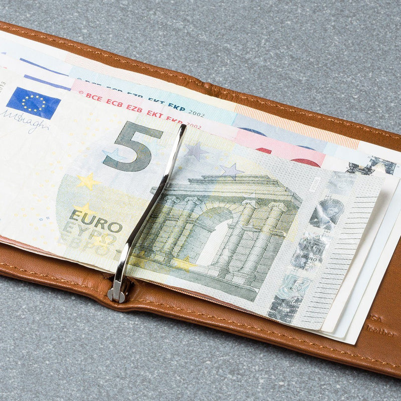 euro bills attached to a money clip in the hickory leather wally euro travel wallet