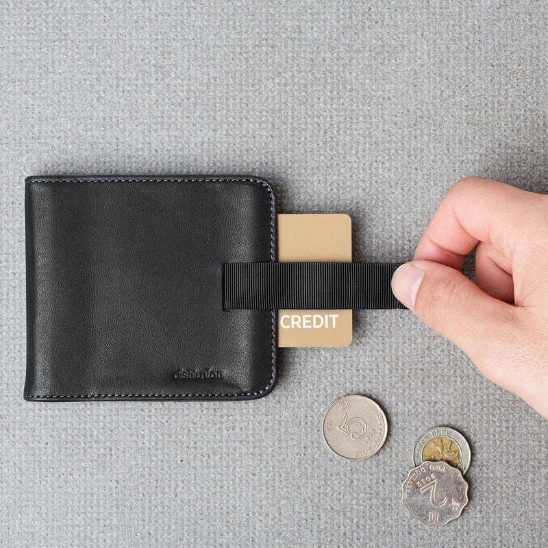 hand using pull-tab to extract brown card from black leather wally euro travel wallet