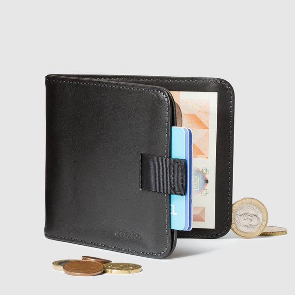 coins around distil black leather bifold travel wallet half open with pull-tab