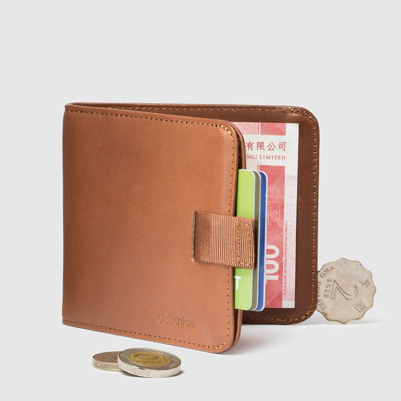 coins around distil hickory leather bifold travel wallet half open with pull-tab