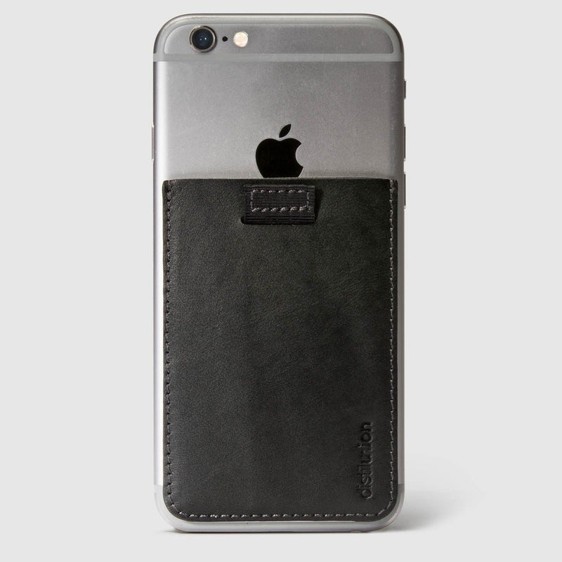 distil black leather wally junior stick-on on the back of an iphone with a pull-tab