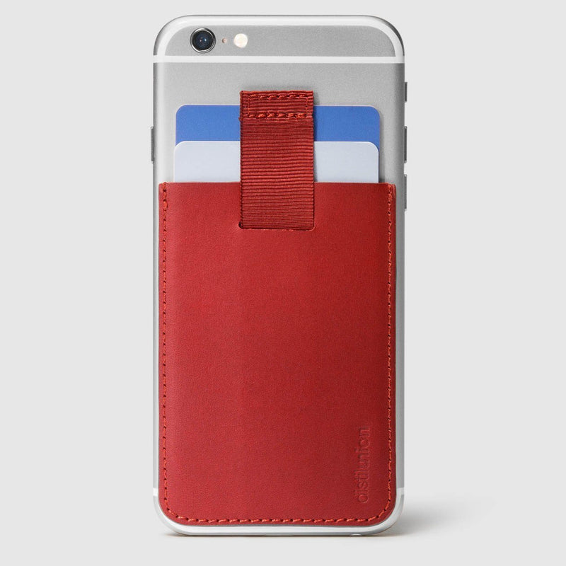 red leather wally junior stick-on attached to iphone with a pull-tab withdrawing cards